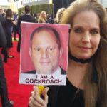 Charlotte Laws with Harvey Weinstein sign at Golden Globes