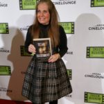 Charlotte Laws on the Red Carpet in 2018 with her book, Devil in the Basement
